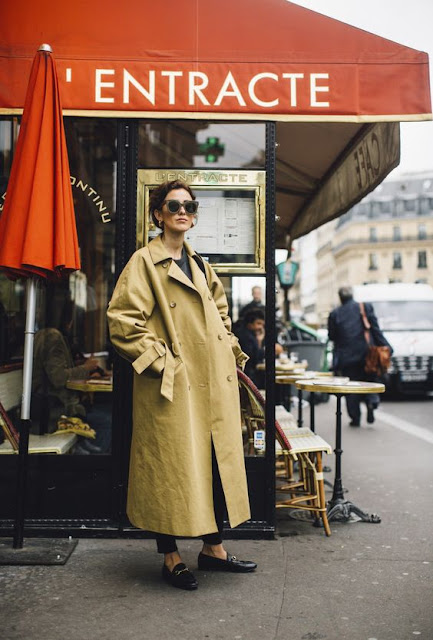 woman in an over-sized trench coat