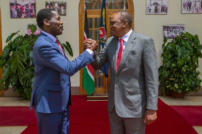 Peter Munya with the President Uhuru Kenyatta. PHOTO | PSCU