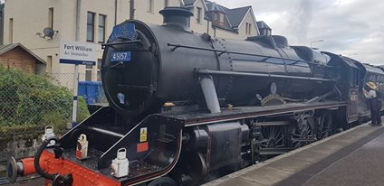 The black Jacobite steam train (or the Hogwarts Express) at Fort William train station
