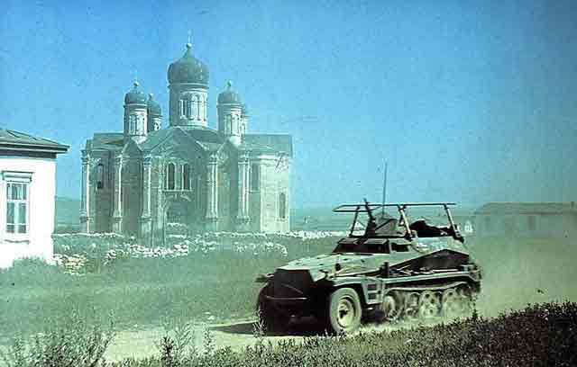 A German Sdkfz 250 passes by Russian Eastern Orthodox Church. 7 October 1941 worldwartwo.filminspector.com