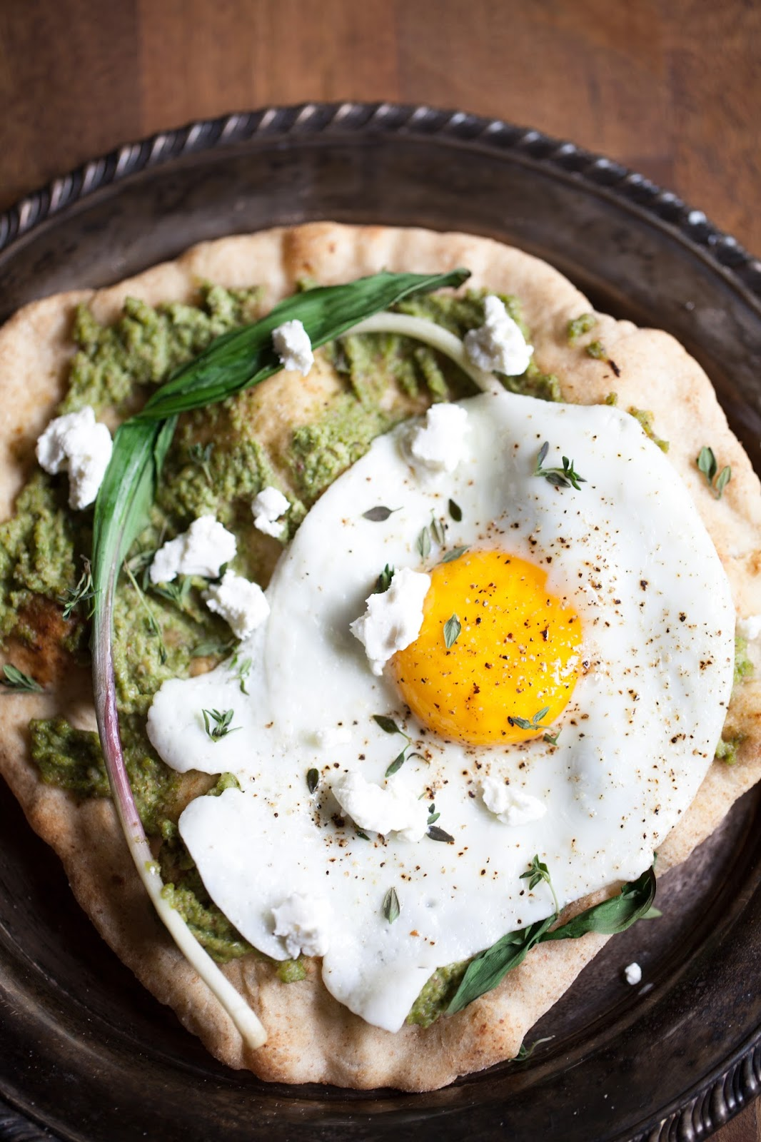 asparagus pesto pizza with ramps and a fried egg