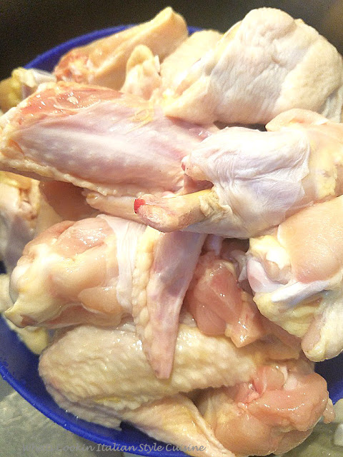 these are whole chicken wings cut in half instructions and video on how to make fried hot wings after learning how to cut up the whole wings in the video. The chicken wings are shaken in a Southern flour, coated , fried and then poured hot wing sauce over them