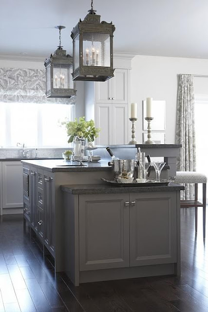 Farmhouse kitchen by Sarah Richardson with lanterns over island