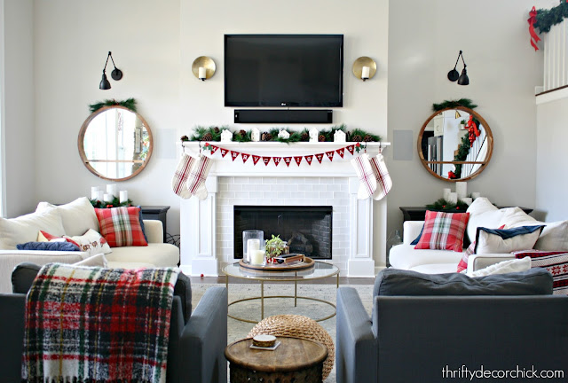 tall fireplace with symmetrical sofa layout