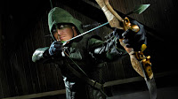 Arrow à Raw !? comics catch superheros catcheur adaptation confrontation costume bd bande-dessinée américain américaine sport duel archer arc fleche bagarre ring corde spectacle