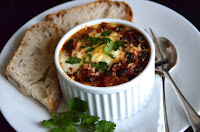 MEXICAN BAKED EGGS WITH BLACK BEANS, TOMATOES, CHILLI AND CORIANDER