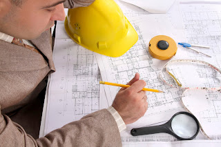 Man reviews architectural plans for safety issues.