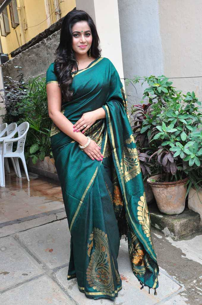 Tollywood Actress Poorna Stills In Green Saree At Fashion Studio Launch