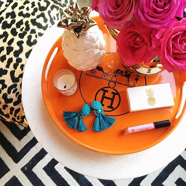 h&m turquoise earrings, turquoise tassel earrings, hermes tray, orange hermes tray, pineapple candle, west elm pineapple candle, lulu and georgia rug, leopard print pillows, best anastasia beverly hills lip gloss, mimosa dipytqye candle, little design co pillows