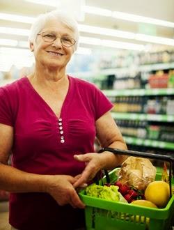 Mature shopper in supermarket with basket