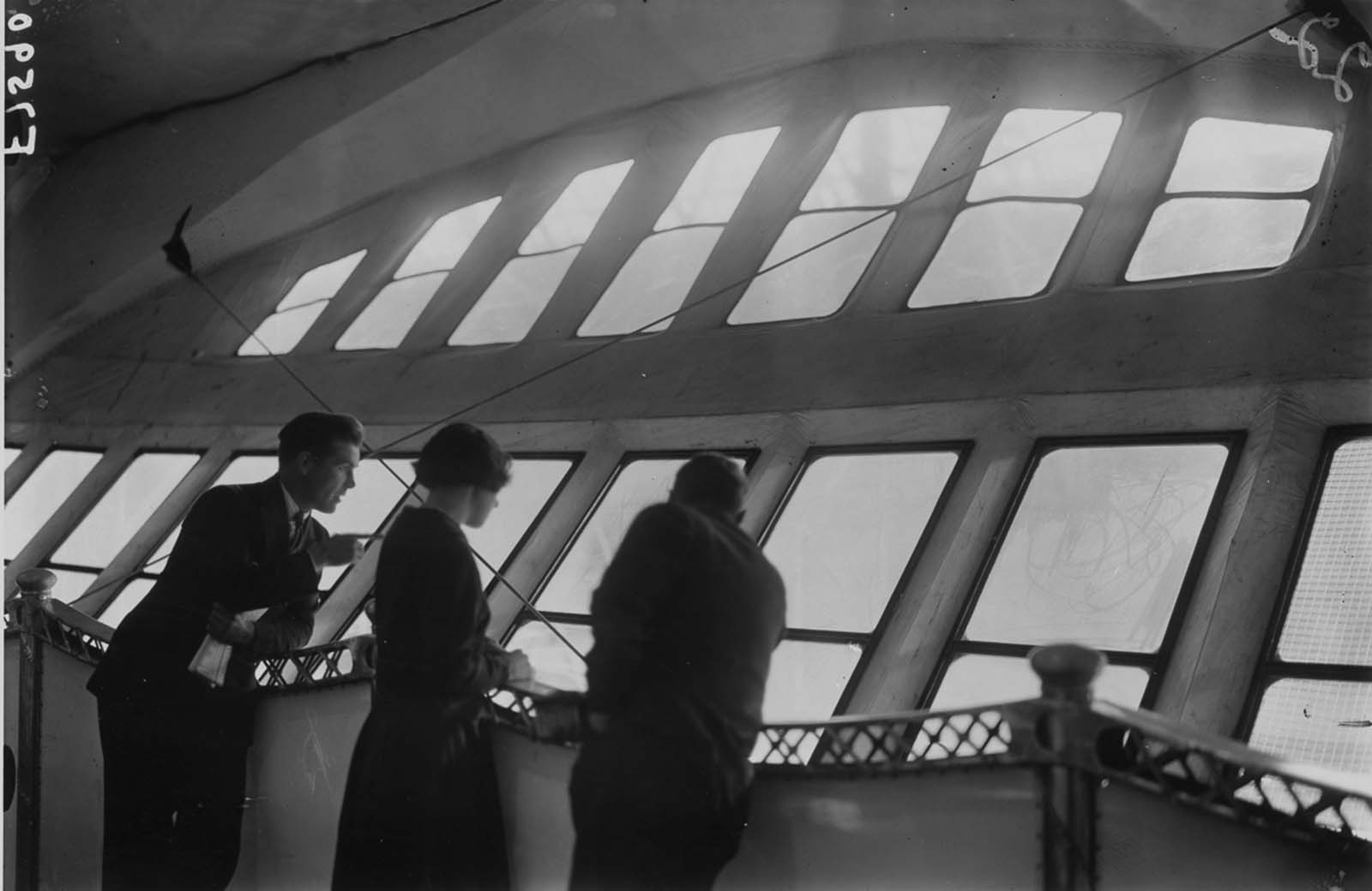 Passengers admire the view from the veranda deck of the R-100. 1929.