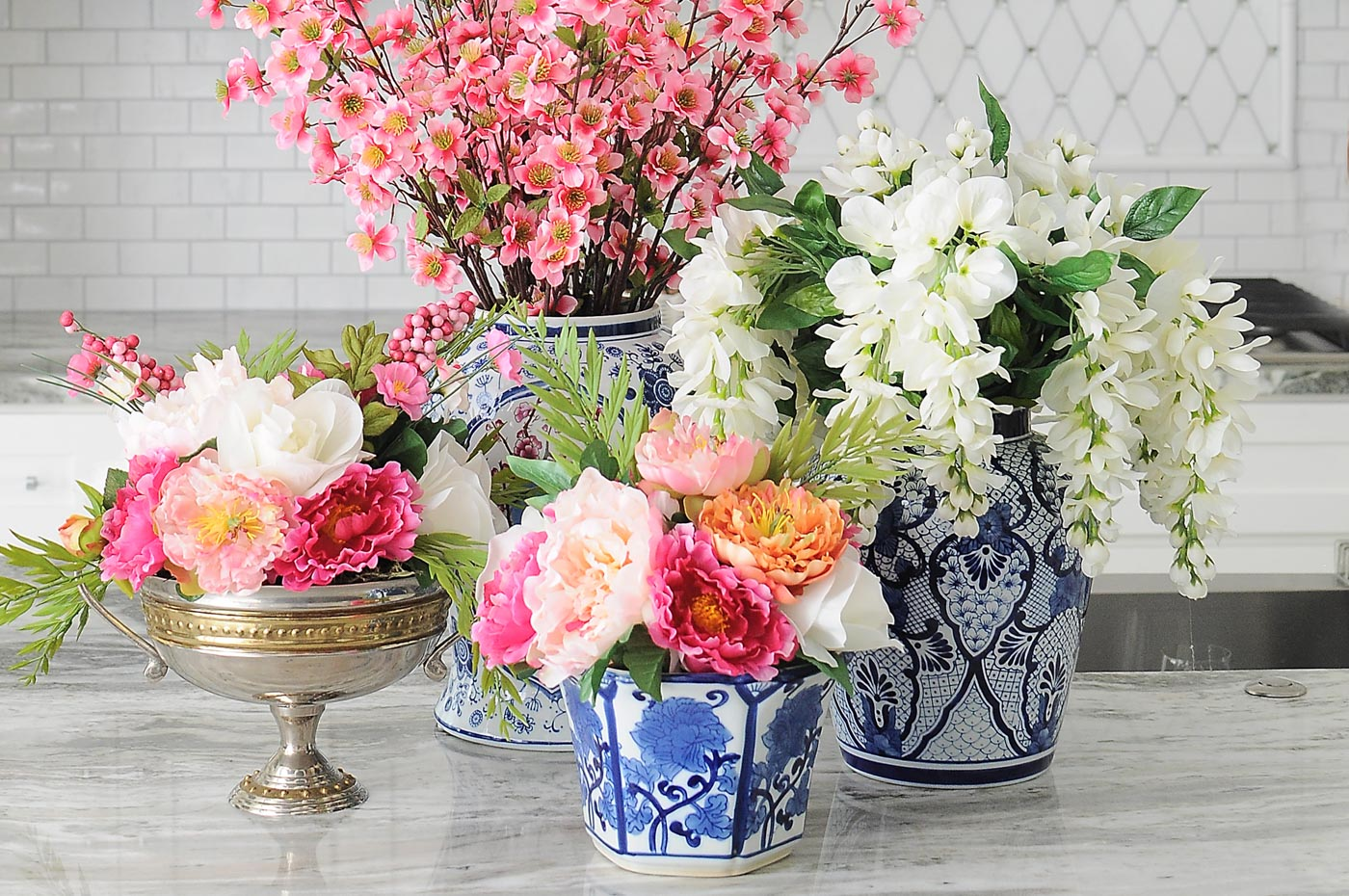 Definitely using this tutorial for how to make faux floral arrangements! These are gorgeous.