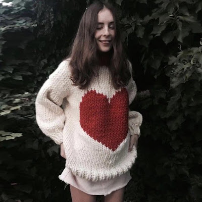 https://www.sevengrils.com/ivory-crew-neck-long-sleeves-heart-printed-chunky-sweater.html