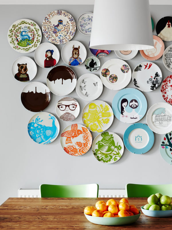 Place Whimsical Decorative Plates on Wall in Kitchen for a Fun Look