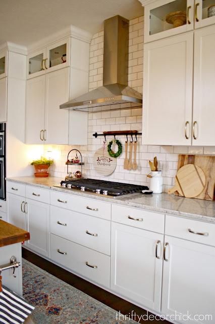 white kitchen with white wavy subway tile