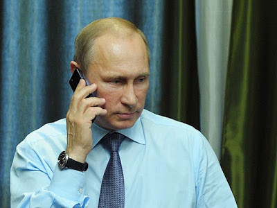 Vladimir Putin with telephone.