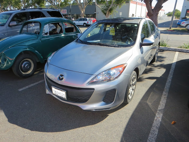 2013 Mazda 3 with new bumper and factory paint from Almost Everything Auto Body.