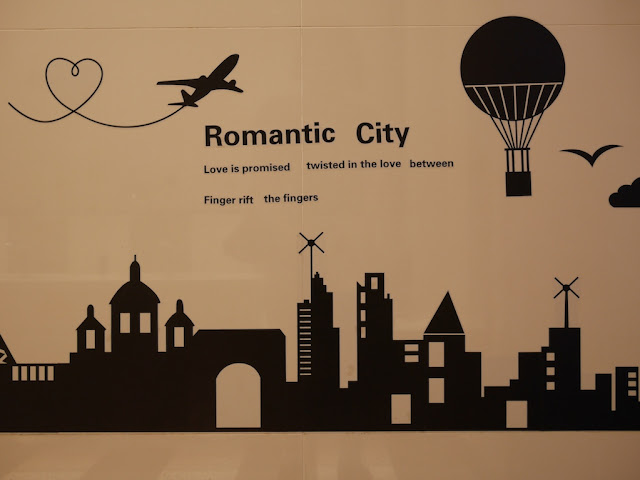city themed decal on a bathroom wall