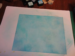 Card coloured to be mottled turquoise blue