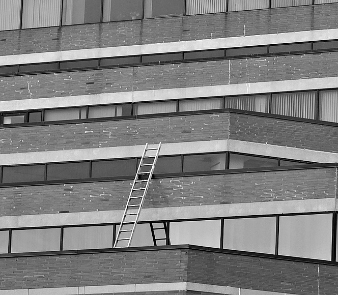 Portland, Maine USA photo by Corey Templeton. A Thursday Throwback to March 2010. Someone must have been busy climbing this corporate ladder at One City Center.