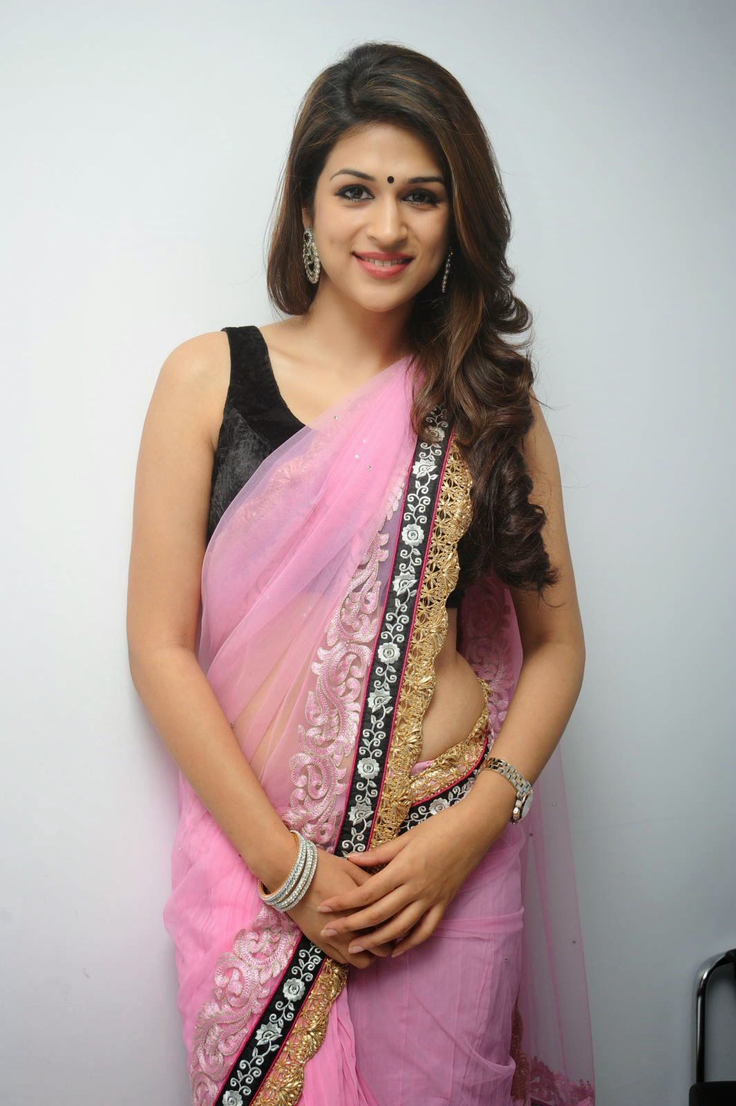 c38ba809415637 Pink Net saree with gold and silver border with black velvet blouse design