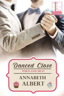 Cover of Danced Close, featuring two white people in suits dancing together. One suit is very pale grey; the other is dark blue. Both people wear bow ties. In true romance novel fashion, the top of the cover cuts off their heads, while the lower bodies are obscured by the title.
