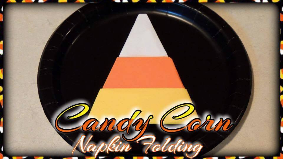 this candy corn napkin fold is quick and easy for a fun halloween table setting