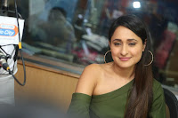 Pragya Jaiswal in a single Sleeves Off Shoulder Green Top Black Leggings promoting JJN Movie at Radio City 10.08.2017 043.JPG
