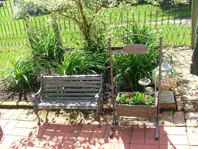 children's bench on brick patio
