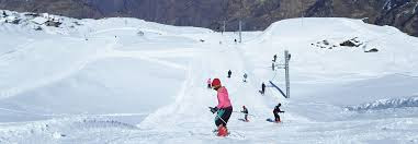 Skiing in snow covered Auli
