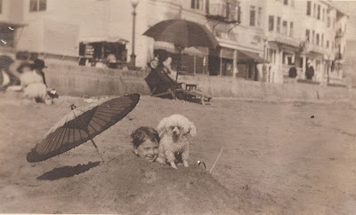 John Jr. and poodle at New York beach about 1921 from album of Mary Theresa Sheehan Killeen Walsh