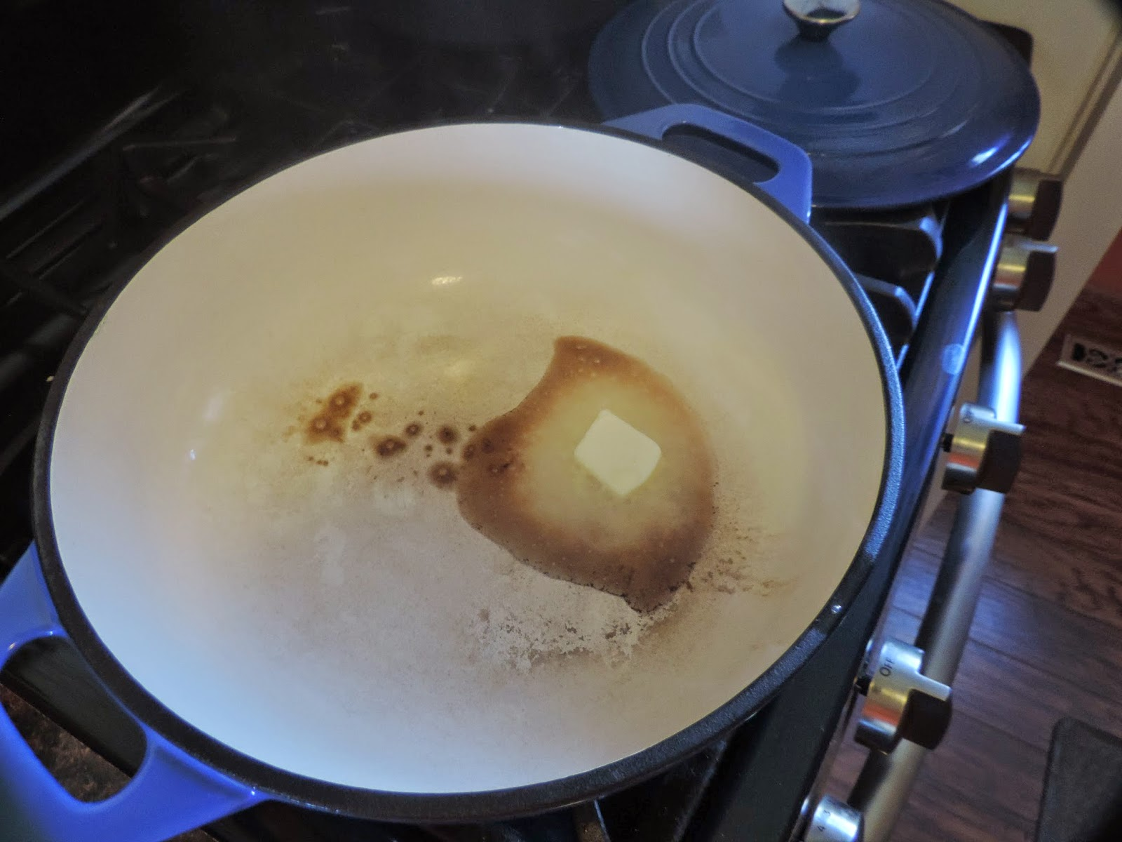 Butter melting in a dutch oven.