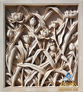 Relief bunga tulip dari batu alam paras jogja atau batu alam paras putih