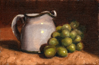 Oil painting of a white porcelain milk jug beside a bunch of green plastic grapes.