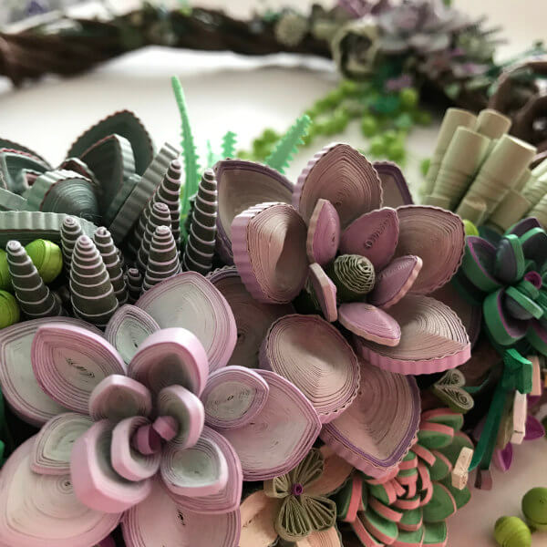 quilled succulent wreath portion with pink and green plants
