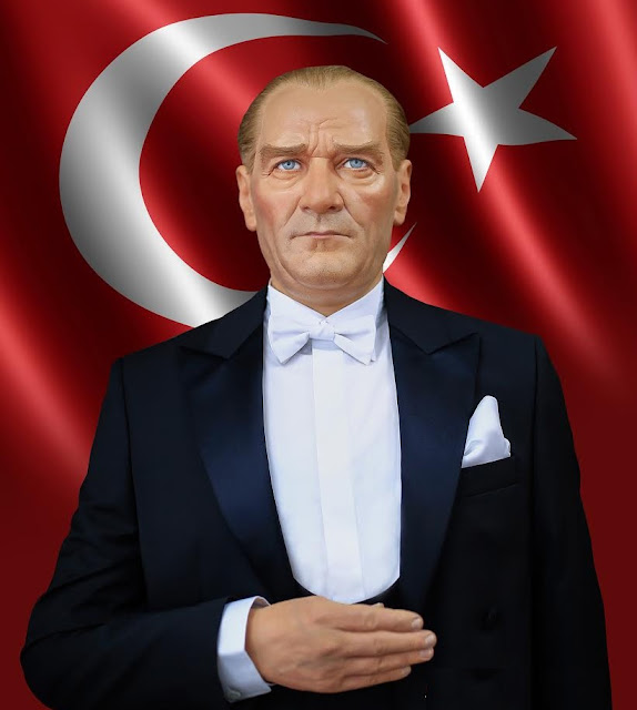 Mustafa Kemal Atatürk in front of Turkish flag