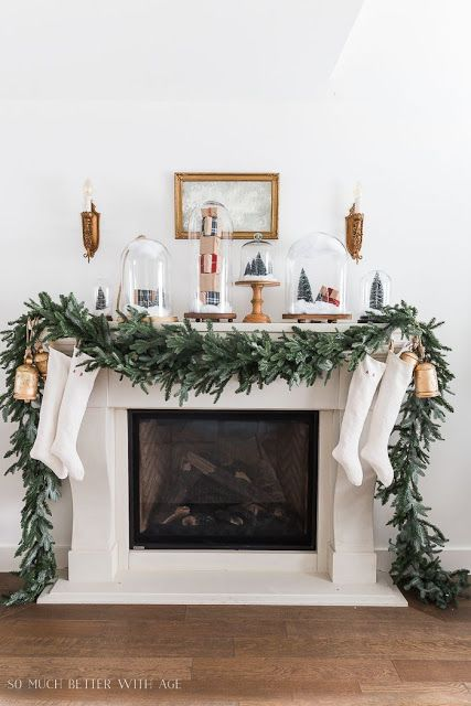 Christmas mantel decor with cloches