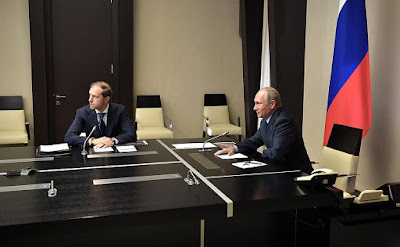 Vladimir Putin listened to a report via videoconference on the destruction of Russian last remaining chemical weapons. With Minister of Industry and Trade Denis Manturov.