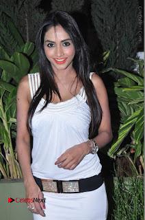Actress Model Pooja Sri Stills in White Short Dress at F Club pre soft Launch  0024.JPG