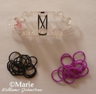 Working a black and purple alternating bracelet design