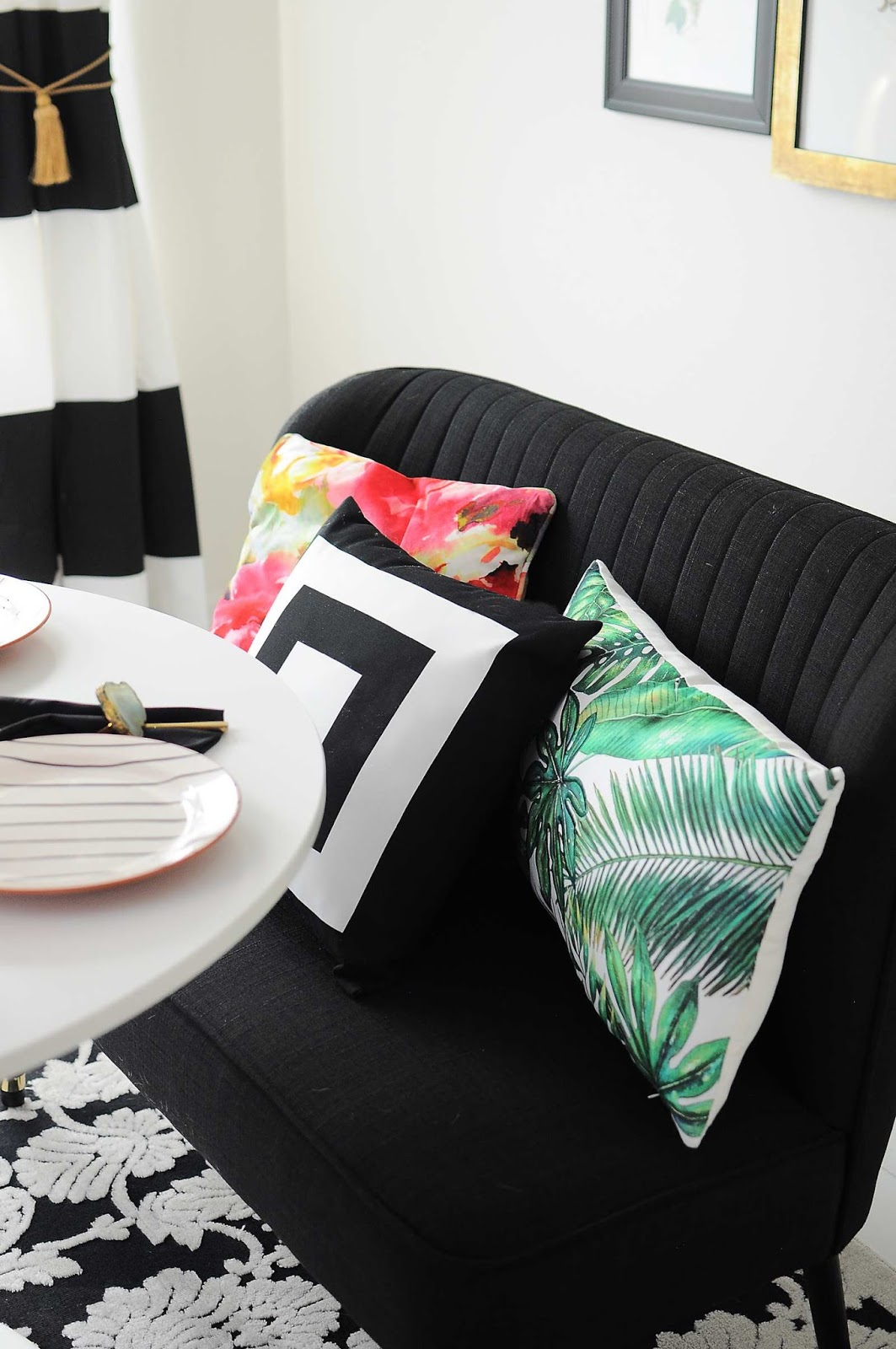 Colorful pillows add style and personality to a dining room bench.
