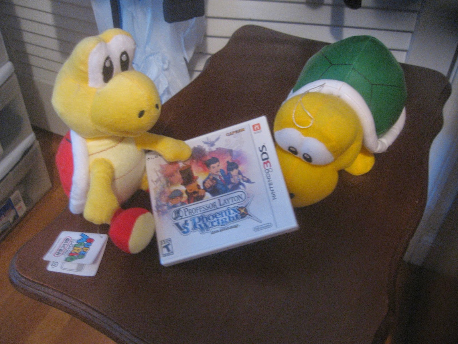Koopa Troopa plush presenting Professor Layton Vs. Phoenix Wright: Ace Attorney.