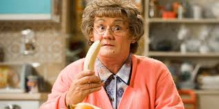 photo of the television character Mrs. Brown holding a banana