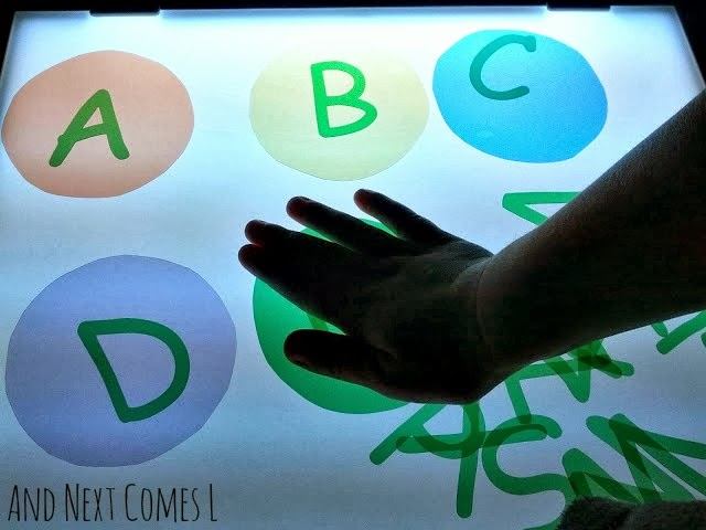 DIY transparent alphabet manipulatives for light table play from And Next Comes L