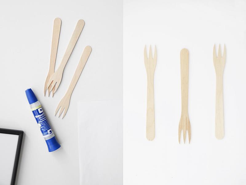 Einfache DIY-Geschenkidee: Gerahmtes Bild mit Holzgabeln, schlichte, günstige Wanddeko Kunst im skandinavisch minimalistischen Stil selbermachen aus Besteck. Deko für die Küche in schwarz-weiß. Tasteboykott Blog.
