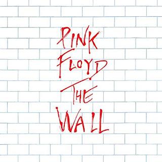 """Portada del álbum de Pink Floyd, The Wall, 1979. Se muestra el texto en rojo sobre un fondo """"enladrillado"""" blanco"""