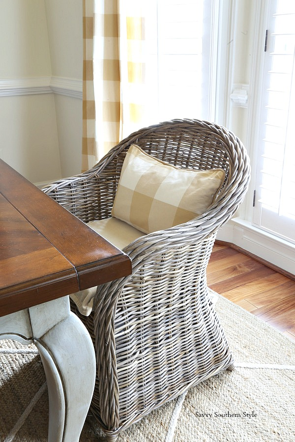 wicker or kubu chairs as host and hostess chairs in French country style dining room