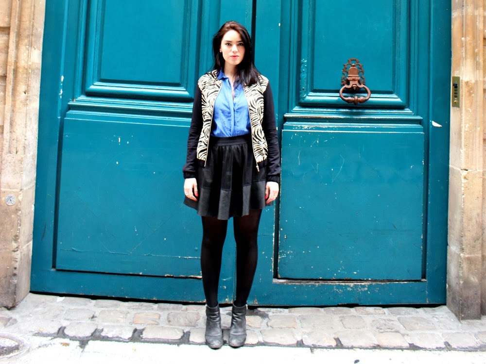 Fashion blogger Emma Louise Layla in Paris wearing a blue silk Sandro shirt