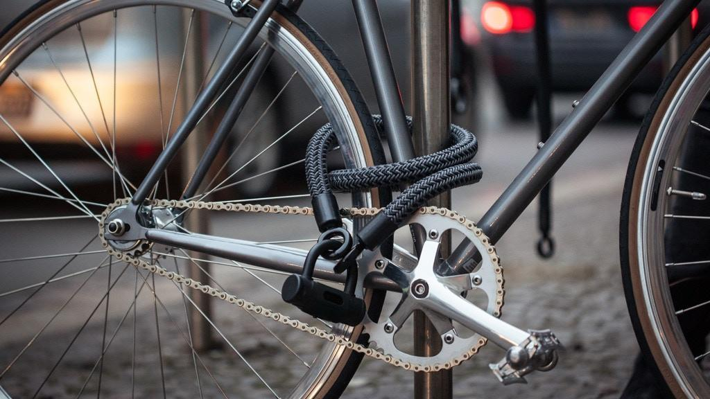 A bike is locked by a durable and well-made bicycle lock