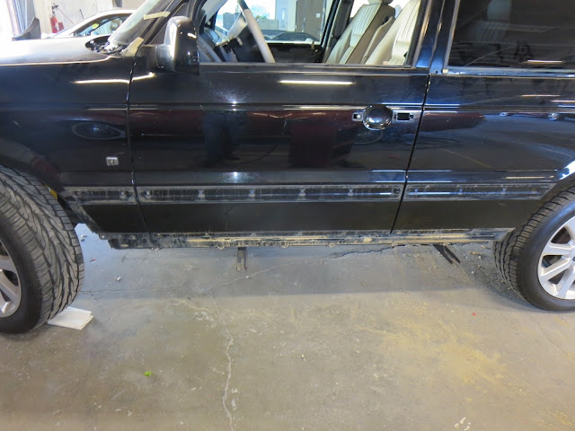 Cleaning mud out of the nooks and crannies on Range Rover.